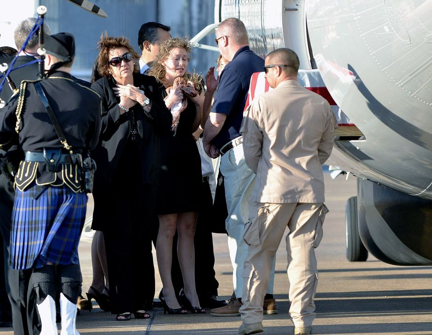 Family members of ICE Special Agent Jaime Zapata receive his body at the Brownsville, Texas, on Friday. He died Tuesday after gunmen ambushed his U.S. government vehicle in Mexico. (Associated Press)
