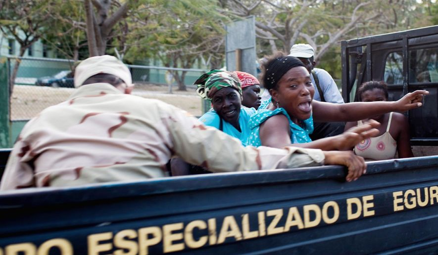 A group of detained Haitian women are driven away by Dominican military border officers in Jimani, Dominican Republic, late last month. After a one-year easing following the January 2010 Haitian earthquake, deportations have resumed. (Associated Press)