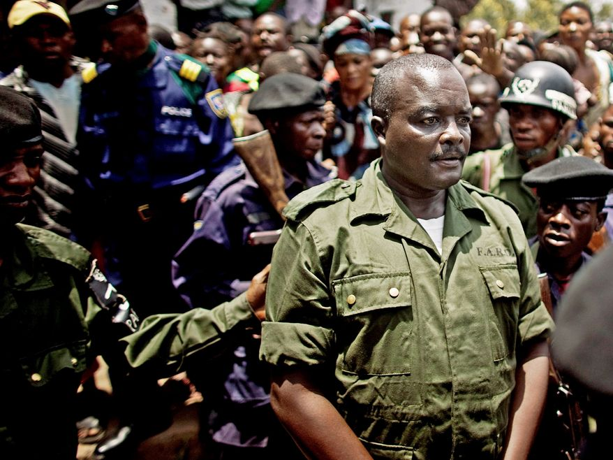 Lt. Col. Mutuare Daniel Kibibi exits a mobile military tribunal after being convicted of crimes against humanity in the town of Baraka, Congo, on Monday. (Associated Press)
