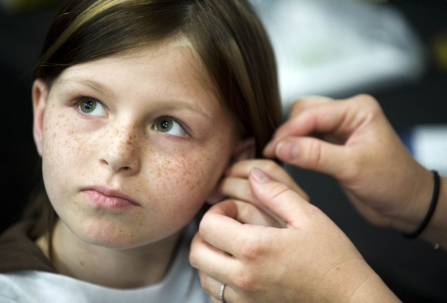 ** FILE ** Zahra Clare Baker, 10, of Hickory, N.C., receives a hearing aid during an event at the Charlotte Motor Speedway in Charlotte, N.C., in May 2010. Elisa Baker, Zahra's stepmother, was indicted on Monday, Feb. 21, 2011, on a second-degree murder charge in the child's death. (AP Photo/Independent Tribune, James Nix, File)