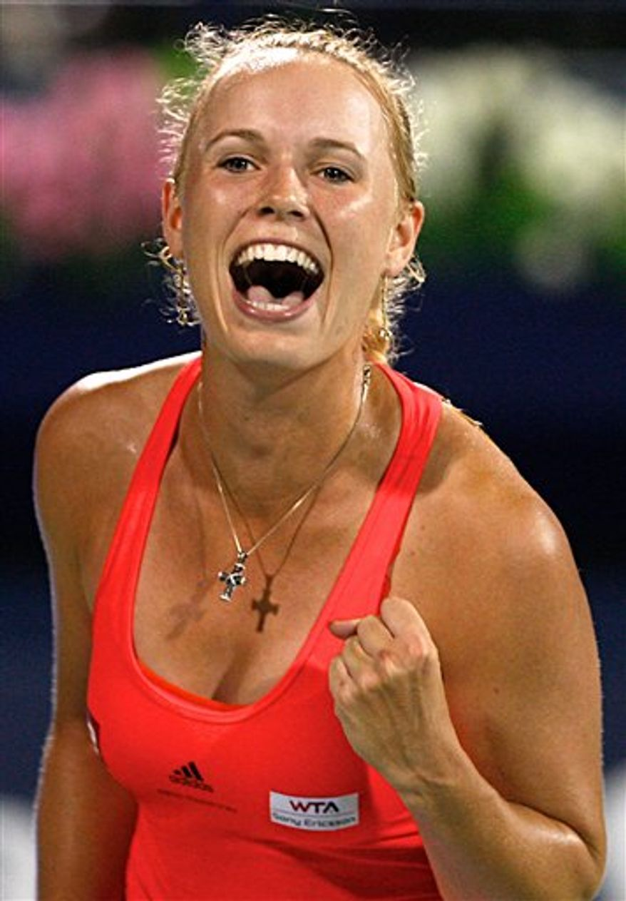 Carolina Wozniacki of Denmark reacts after winning the match against Russia's Svetlana Kuznetsova during the final of the Emirates Dubai WTA Tennis Championships in Dubai, United Arab Emirates Sunday, Feb. 20, 2011. (AP Photo/Nousha Salimi)