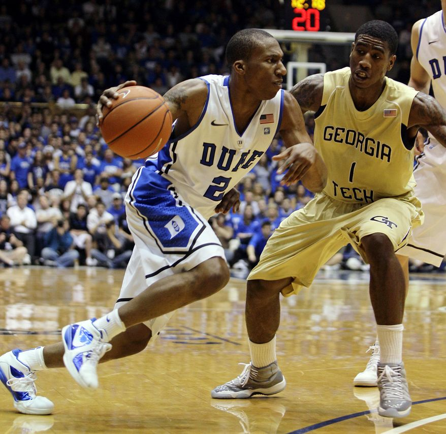 Duke's Nolan Smith (2) drives to the basket as Georgia Tech's Iman Shumpert (1) defends during the first half of Duke's 79-57 victory Sunday in Durham, N.C. (Associated Press)
