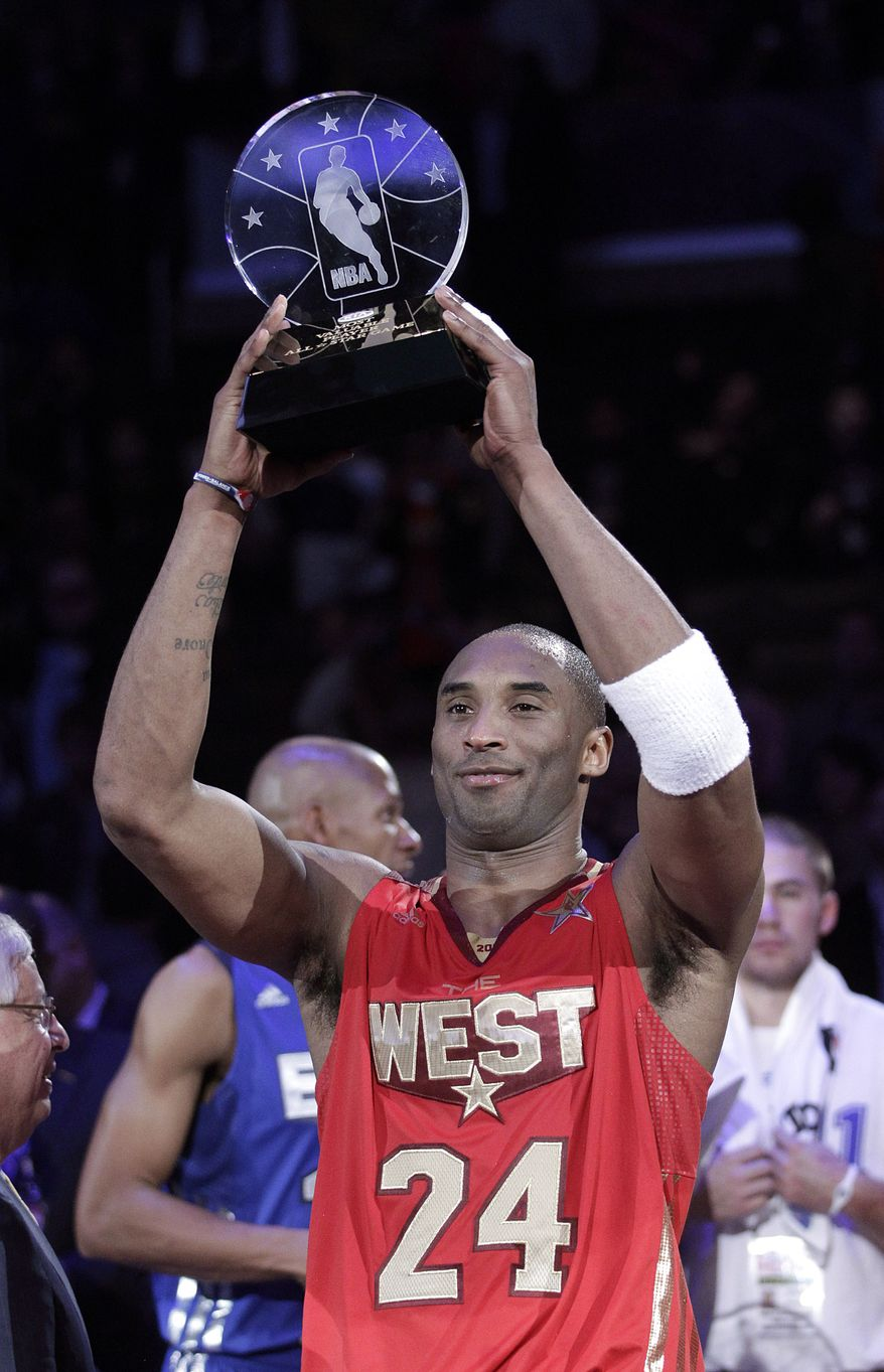 West's Kobe Bryant holds up the MVP trophy after the NBA's All-Star Game in Los Angeles on Sunday. The West won 148-143. (Associated Press)