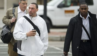 Pittsburgh Steelers quarterback Charlie Batch (center), New York Jets fullback Tony Richardson (right) and former NFL player Pete Kendall arrive for talks on the NFL labor deal on Monday in Washington. After months of infrequent, and sometimes contentious bargaining, the league and union have met every day since Friday, to come to terms over a series of issues, not least of which is how to divide about $9 billion in annual revenues. (Associated Press)