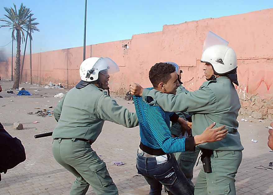 A protester is arrested in Marrakech, Morocco, during one of a string of nationwide protests that brought thousands to the streets across Morocco on Sunday, Feb. 20, 2011, in an effort to push for greater democracy and constitutional reform. Protesters in Morocco and other Arab nations may also be wary as they watch Tunisia and Egypt grapple with the challenges of building a new system and maintaining order after breaking free of autocrats. (AP Photo/Tarik Najmaoui)