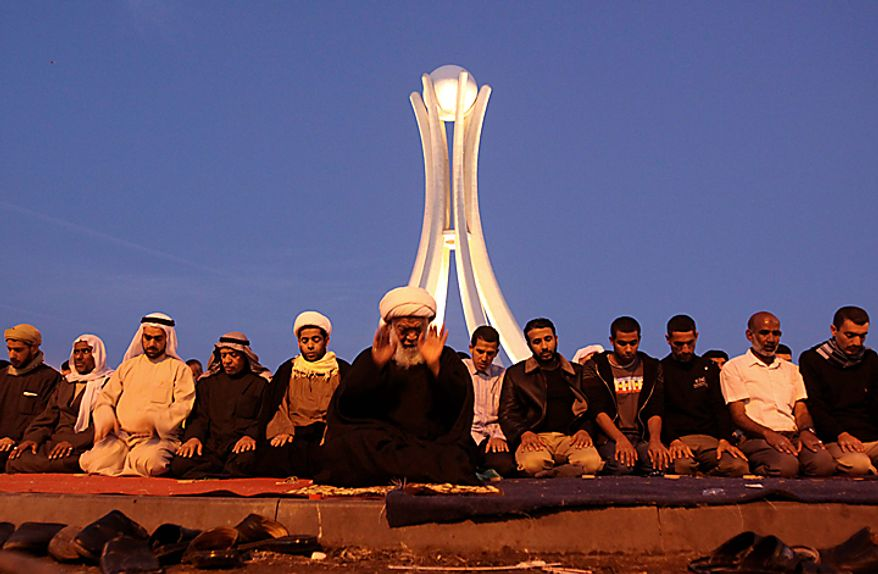 Bahraini anti-government protesters pray at the Pearl Square in Manama, Bahrain, on Sunday, Feb. 20, 2011. Bahrain's opposition leaders gathered Sunday to examine offers for talks from Bahrain's rulers after nearly a week of protests and deadly clashes that have sharply divided the strategic Gulf nation. (AP Photo/Hasan Jamali)