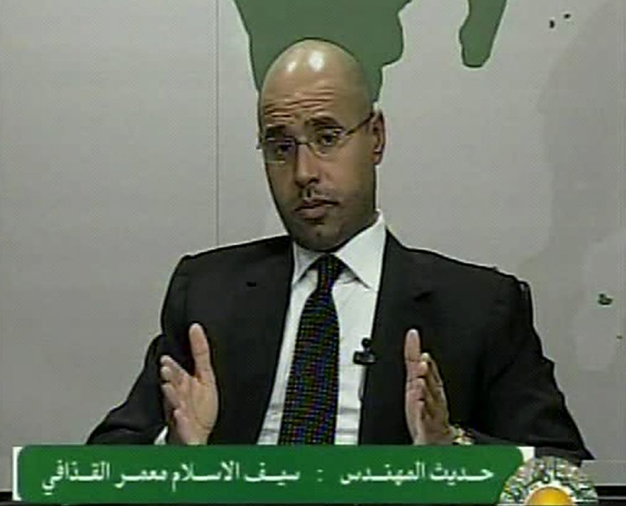 In this video image broadcast on Libyan state television early on Monday, Feb. 21, 2011, Seif al-Islam, a son of longtime Libyan leader Moammar Gadhafi, speaks. Mr. al-Islam says protesters have seized control of some military bases and tanks, and he warned of civil war in the country that would burn its oil wealth. (AP Photo/Libyan State Television)