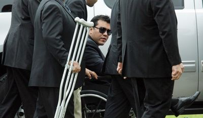 Agent Zapata's partner, Victor Avila, who was wounded in the leg, arrives at Rose Lawn Memorial Gardens in Brownsville. The agents were assigned to the attache office in Mexico City. (Associated Press)