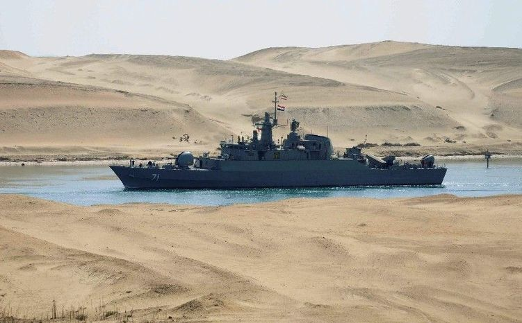 The Iranian navy frigate IS Alvand passes through the Suez Canal at Ismailia, Egypt, on Tuesday, accompanied by the supply ship IS Kharg (not pictured) en route to Syria on a training mission. (Associated Press)