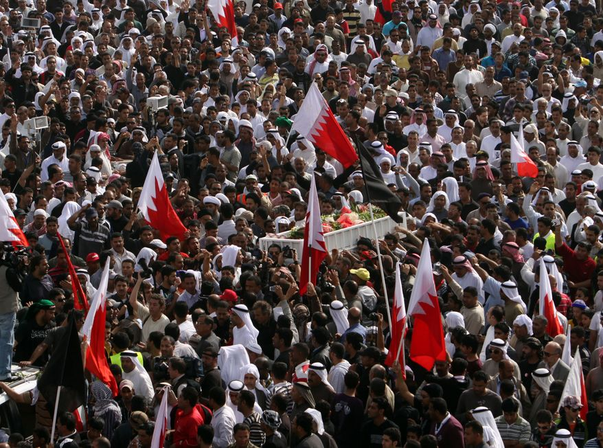 Thousands of Bahraini mourners participate in a funeral march on Tuesday, Feb. 22, 2011, in Malkiya, Bahrain, for Redha Bu Hameed, who died during clashes between army forces and anti-government protesters. (AP Photo/Hasan Jamali)