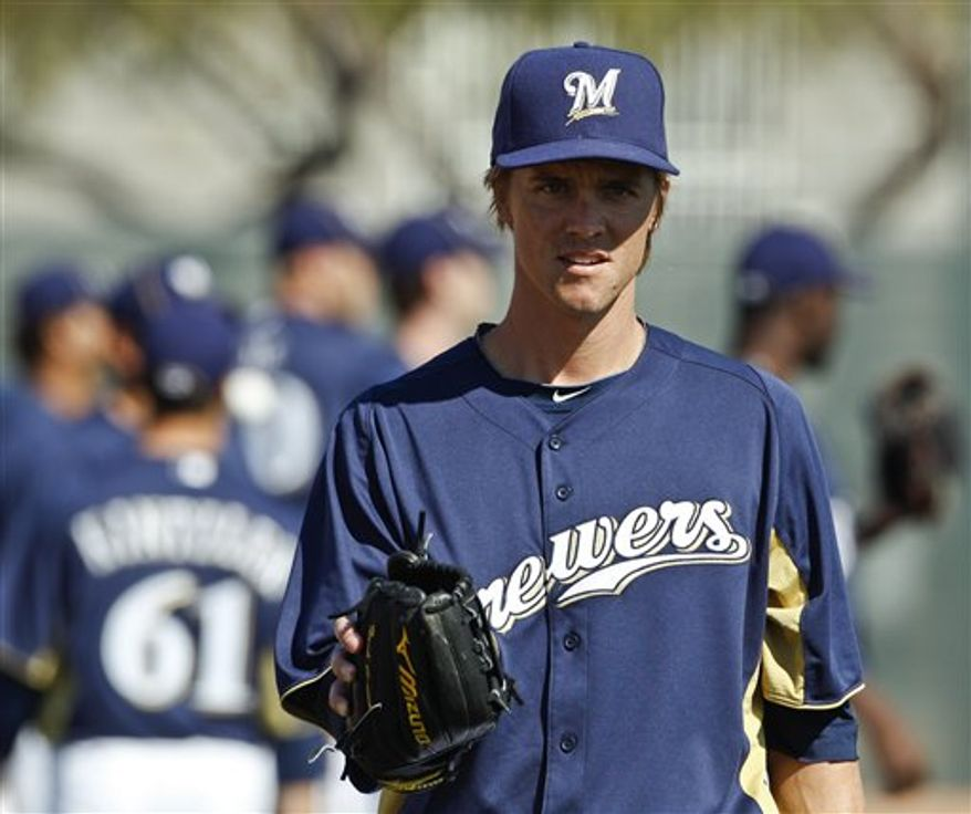 Milwaukee Brewers' Zack Greinke gets ready to stretch during baseball spring training, Tuesday, Feb. 22, 2011, in Phoenix. (AP Photo/Morry Gash)