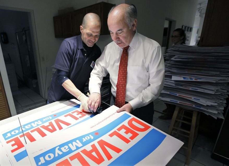 Chicago mayoral candidate Miguel del Valle (right) assembles campaign signs with volunteer Israel Martinez at his campaign headquarters on Monday, Feb. 21, 2011, in Chicago. Six candidates are on Tuesday's ballot to replace the retiring Mayor Richard M. Daley, who didn't seek a seventh term. (AP Photo/M. Spencer Green)