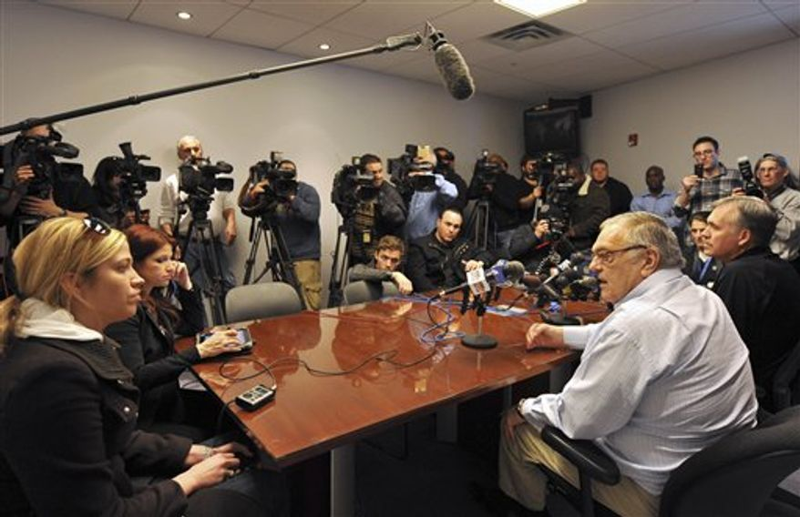 Donnie Walsh, second from right, New York Knicks president of basketball operations, and head coach Mike D'Antoni, right, answers questions from the media concerning the recent trade for the Denver Nuggets' Carmelo Anthony during a news conference at the team's NBA basketball training facility on Tuesday, Feb. 22, 2011 in Greenburgh, N.Y. (AP Photo/Kathy Kmonicek)
