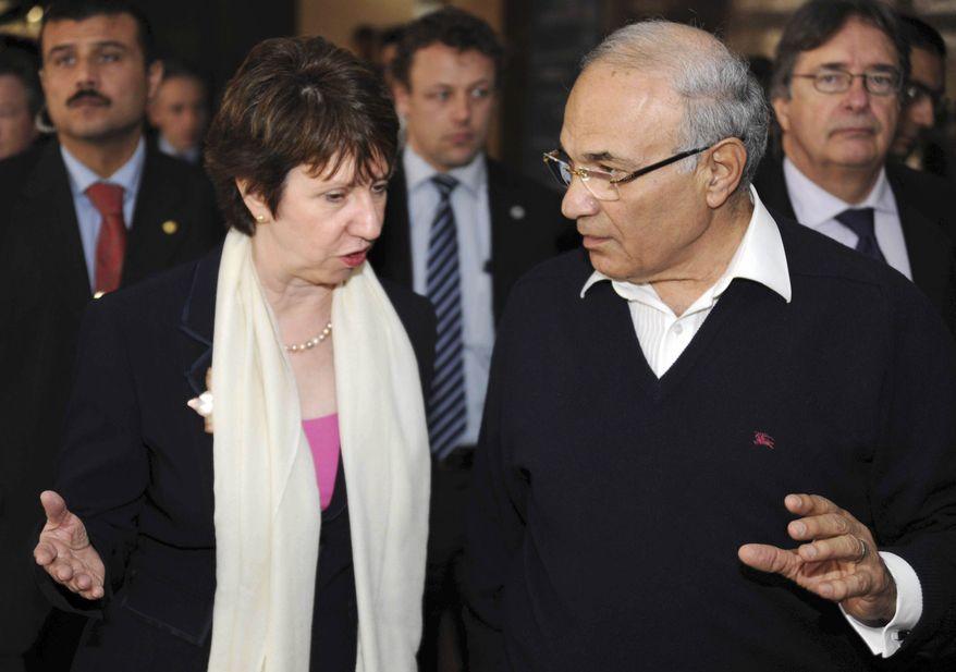 European Union Foreign Policy Chief Catherine Ashton talks to Egyptian Prime Minister Ahmed Shafiq in Cairo, Egypt,Tuesday, Feb. 22, 2011. (AP Photo/Seliman al Oteifi)