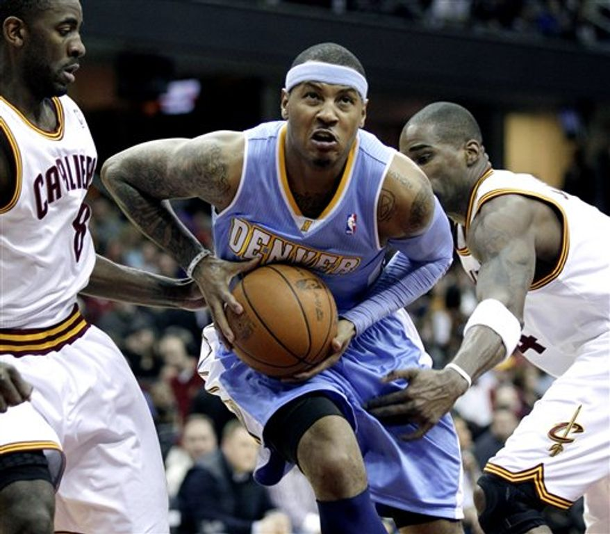 In this Nov. 24, 2010, photo, New York Knicks' Wilson Chandler (21); Danilo Gallinari (8), of Italy; and Raymond Felton (2) gather an NBA basketball game against the Charlotte Bobcats in Charlotte, N.C. The Knicks have agreed to a trade with the Denver Nuggets for Carmelo Anthony, a person familiar with the deal told The Associated Press on Monday night, Feb. 11, 2011. The Denver Post, citing a league source, said the Knicks would send Chandler, Felton, Gallinari, Timofey Mozgov and a 2014 first-round draft pick to the Nuggets, who would get additional picks and cash. Along with Anthony, New York would acquire Chauncey Billups, Shelden Williams, Anthony Carter and Renaldo Balkman, according to the Post. (AP Photo/Chuck Burton)