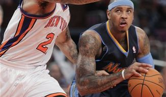 "In this Dec. 12, 2010, photo, Denver Nuggets' Carmelo Anthony, right, works against New York Knicks' Wilson Chandler during an NBA basketball game in New York. Anthony acknowledged after his 38-point performance in Milwaukee on Wednesday night, Feb. 16, that he has no idea what will happen as trade talks surely intensify this All-Star weekend. ""I'm waiting to see just like (everybody else),"" he said. (AP Photo/Seth Wenig)"