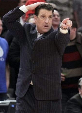 St. John's head coach Steve Lavin directs his team during the second half of an NCAA college basketball game against Pittsburgh, Saturday, Feb. 19, 2011 at Madison Square Garden in New York. St. John's defeated No. 4 Pittsburgh 60-59.  (AP Photo/Mary Altaffer)