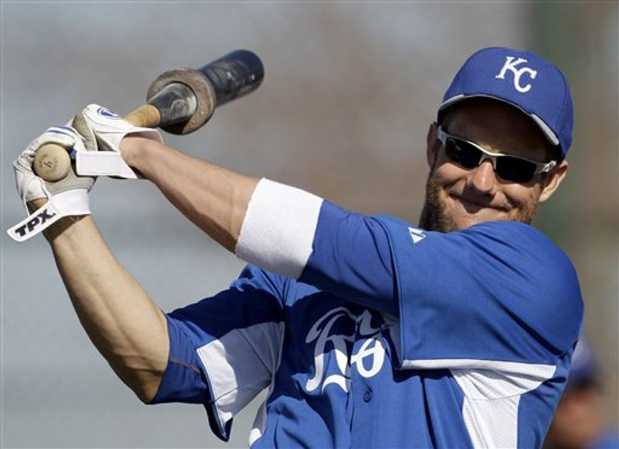 Kansas City Royals' Alex Gordon walks between practice fields during baseball spring training Tuesday, Feb. 22, 2011, in Surprise, Ariz. (AP Photo/Charlie Riedel)