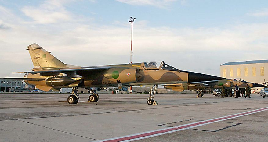 Two Libyan jets are parked at the Malta International Airport in Gudja, Malta, Monday evening, Feb. 21, 2011. The air force jets landed in Malta on Monday and their pilots asked for political asylum amid a bloody crackdown on anti-government protesters in Libya, a military source said. (AP Photo/Lino Arrigo Azzopardi)