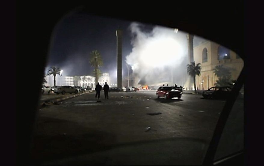 A fire burns in a street in the Libyan capital Tripoli in the early hours Tuesday Feb. 22, 2011, in this image taken from TV.  The bodies of protesters shot to death by forces loyal to Moammar Gadhafi were left on the streets of a restive district in the Libyan capital Tuesday, an opposition activist and a resident said, while the longtime leader defiantly went on state TV to show he was still in charge. (AP Photo/APTN)