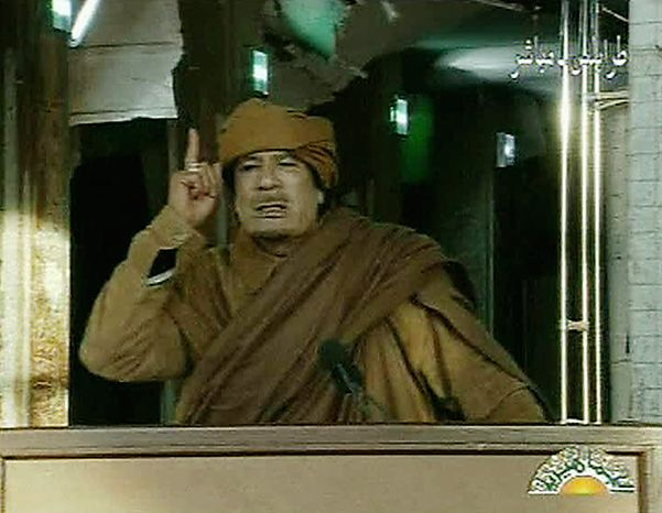 This image broadcast on Libyan state television Tuesday, Feb. 22, 2011, shows Libyan leader Moammar Gadhafi as he addresses the nation in Tripoli, Libya. Col. Gadhafi vowed to fight on against protesters demanding his ouster and die as martyr. (AP Photo/Libya State Television via APTN)