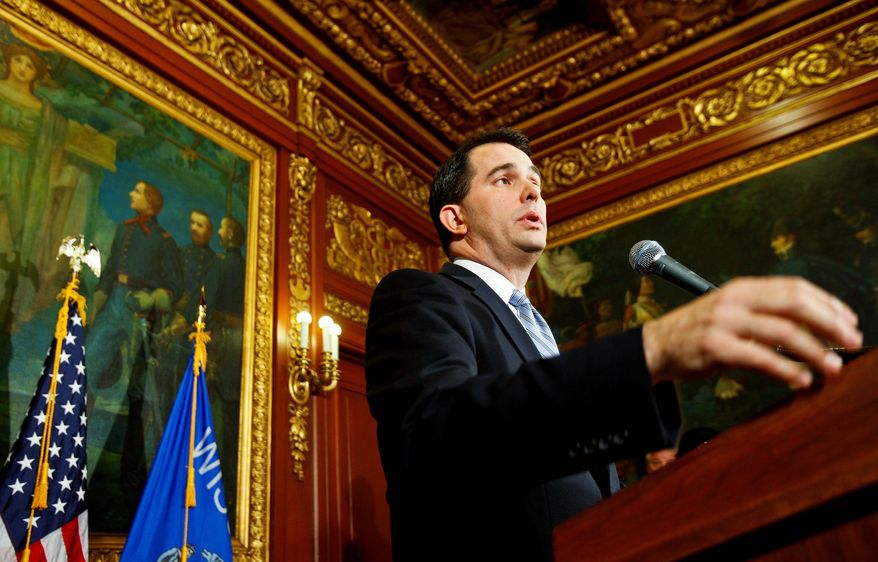 Wisconsin Gov. Scott Walker discusses his proposal to eliminate collective bargaining rights for many state workers in Madison, Wis., on Wednesday. Opponents are in their ninth day of protests. (Associated Press)