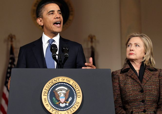 President Obama speaks about the uprising in Libya with Secretary of State Hillary Rodham Clinton present in the Grand Foyer of the White House on Wednesday. (Associated Press)