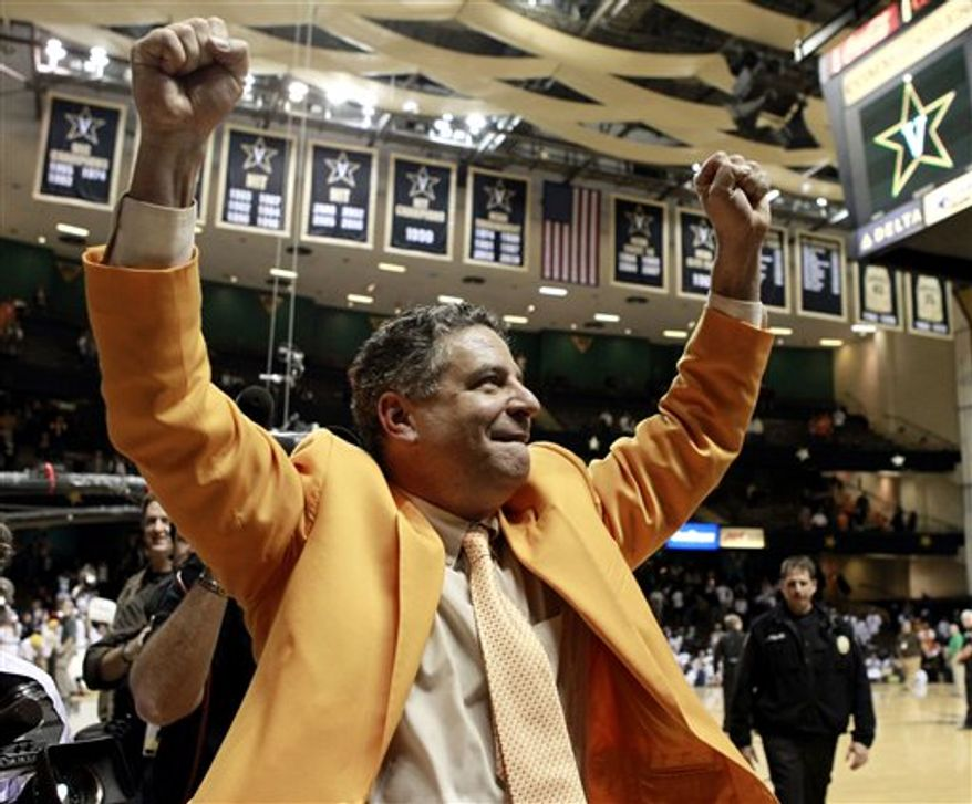 Tennessee coach Bruce Pearl celebrates as he leaves the court after Tennessee upset No. 18 Vanderbilt 60-51 in an NCAA college basketball game on Tuesday, Feb. 22, 2011, in Nashville, Tenn. (AP Photo/Mark Humphrey)