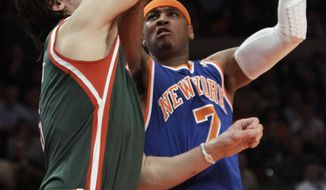 New York Knicks' Carmelo Anthony, right, works against Milwaukee Bucks' Andrew Bogut, of Australia, during the first half of an NBA basketball game Wednesday, Feb. 23, 2011, in New York. (AP Photo/Kathy Willens)