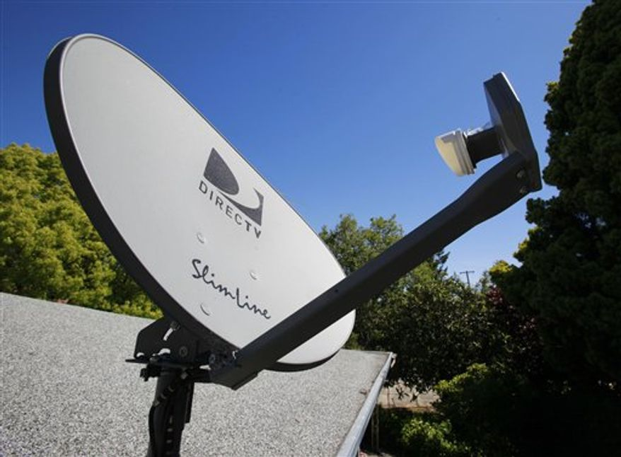 ** FILE ** In this May 6, 2010, file photo, a DirecTV satellite dish is attached to a roof at a home in Palo Alto, Calif. DirecTV, the nation's largest satellite TV operator, said Wednesday, Feb. 23, 2011, it attracted more new subscribers in the fourth quarter than it has in a decade. (AP Photo/Paul Sakuma)