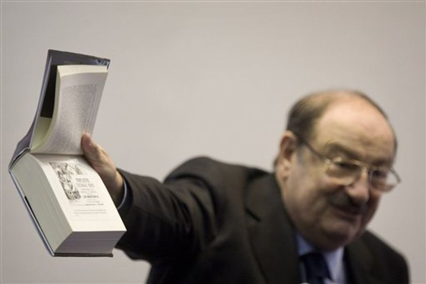 """Italian writer Umberto Eco gestures as he speaks during a press conference at the 25th Annual Book Fair in Jerusalem, Wednesday, Feb. 23, 2011. Celebrated Italian writer Umberto Eco said Wednesday boycotting scholars for their governments' policies is """"a form of racism"""" and """"absolutely crazy."""" But he says he faced no pressure from colleagues to boycott a book fair in Jerusalem to protest Israel's treatment of the Palestinians. (AP Photo/Sebastian Scheiner)"""