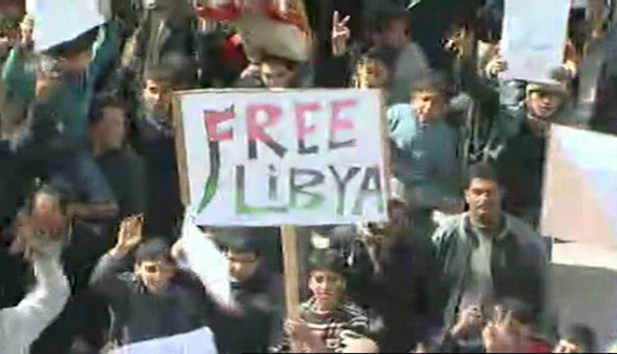 This image taken from TV shows demonstrators in Tobruk, Libya, on Wednesday, Feb. 23, 2011. Gunfire is reported to have broken out in Tripoli, while anti-government protesters claimed control of many cities elsewhere in the country. (AP Photo/APTN)