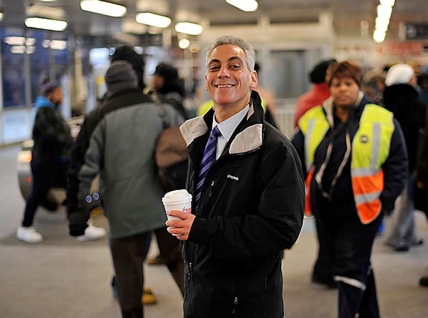 Chicago Mayor-elect Rahm Emanuel smiles as he greets commuters at a train station on Wednesday, Feb. 23, 2011, in Chicago. (AP Photo/Brian Kersey)