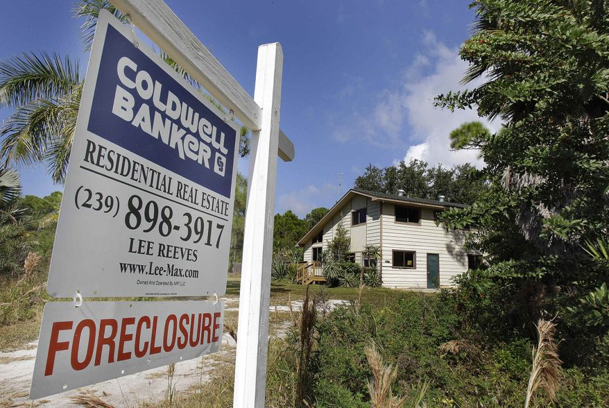 ** FILE ** A foreclosed home is shown on Pine Island in Lee County, Fla., in November 2010. (AP Photo/Chris O'Meara, File)