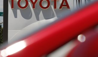 ** FILE ** In this July 27, 2008, file photo, the company sign hangs over a row of 2009 models at a Toyota dealership in the southeast Denver suburb of Centennial, Colo. Toyota Motor Corp. is recalling 2.17 million vehicles in the United States to address accelerator pedals that could become entrapped in floor mats or jammed in carpeting. (AP Photo/David Zalubowski, File)