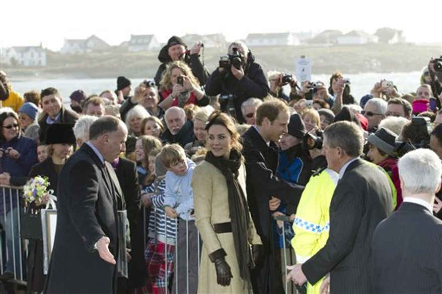 Britain's Prince William and Kate Middleton greet well wishers after after naming a new lifeboat at the Trearddur Bay Lifeboat Station on the island of Anglesey, Wales, Thursday, Feb. 24, 2011. The visit had been highly anticipated because the couple have kept such a low profile since announcing their engagement in November, making only one other prior appearance at a charity event. They plan to marry April 29 at Westminster Abbey with just under 2,000 guests attending.(AP Photo/Jon Super).