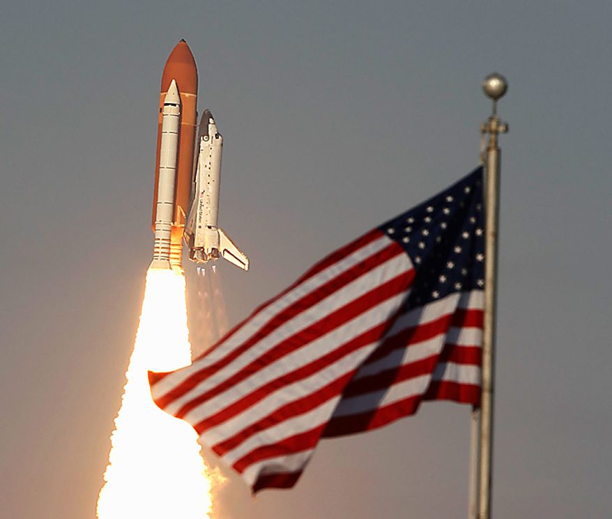 Space shuttle Discovery lifts off from Pad 39A at the Kennedy Space Center in Cape Canaveral, Fla., Thursday, Feb. 24, 2011. The crew of six astronauts are on an 11-day mission to the international space station. (AP Photo/Wilfredo Lee)