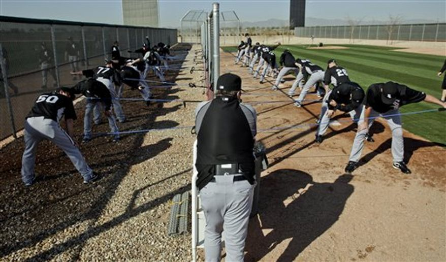 Some Chicago White Sox pitchers warm up during a spring training baseball workout Wednesday, Feb. 23, 2011, in Glendale, Ariz. (AP Photo/Morry Gash)