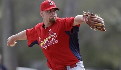 FILE - This Feb. 14, 2011, file photo shows St. Louis Cardinals relief pitcher Kyle McClellan throwing during spring training baseball,  in Jupiter, Fla. McClellan's success as a reliever may be the only thing  keeping him from replacing the injured Adam Wainwright in the Cardinals' starting rotation. (AP Photo/Jeff Roberson, File)