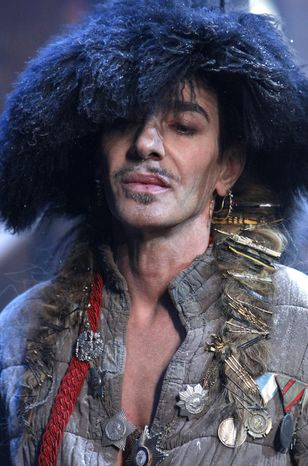 ** FILE ** In this Jan. 21, 2011, file photo, British fashion designer John Galliano appears at the end of his men's fall-winter 2011/2012 fashion collection presented in Paris. (AP Photo/Jacques Brinon, File)