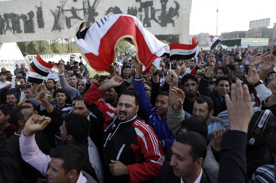 "Protesters chant anti-Iraqi government slogans during a protest at Tahrir Square in Baghdad Friday, Feb. 25, 2011. Hundreds of demonstrators converged on central Baghdad as part of an anti-government rally inspired by uprisings across the Middle East and dubbed the ""Day of Rage."" (AP Photo/Karim Kadim)"