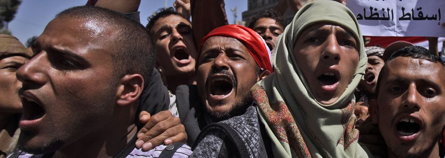 Anti-government protestors chant slogans during a demonstration demanding the resignation of Yemeni President Ali Abdullah Saleh, in Sanaa, Yemen, Thursday, Feb. 24, 2011. (AP Photo/Muhammed Muheisen)