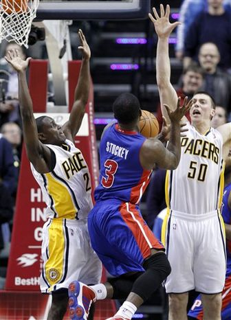 Detroit Pistons forward Tayshaun Prince, right, drives on Indiana Pacers forward Danny Granger in the first half of an NBA basketball game in Indianapolis, Wednesday, Feb. 23, 2011.  (AP Photo/Michael Conroy)