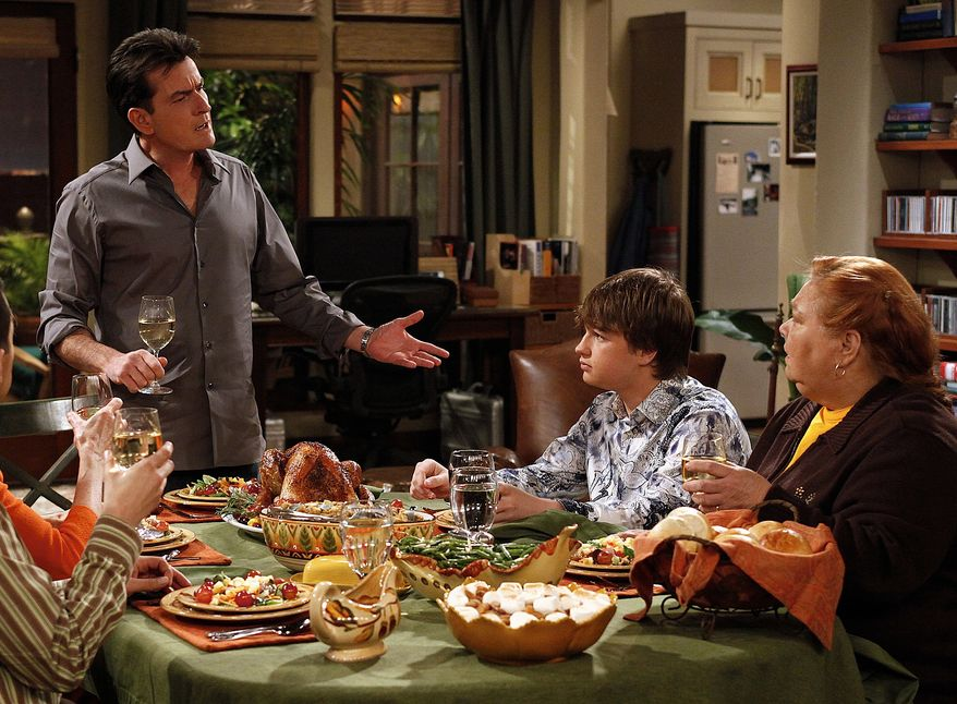 """In this undated publicity image released by CBS, from left, Charlie Sheen, Angus T. Jones and Conchata Ferrell are shown during the taping of """"Two and a Half Men,"""" in Los Angeles. (AP Photo/CBS, Greg Gayne)"""
