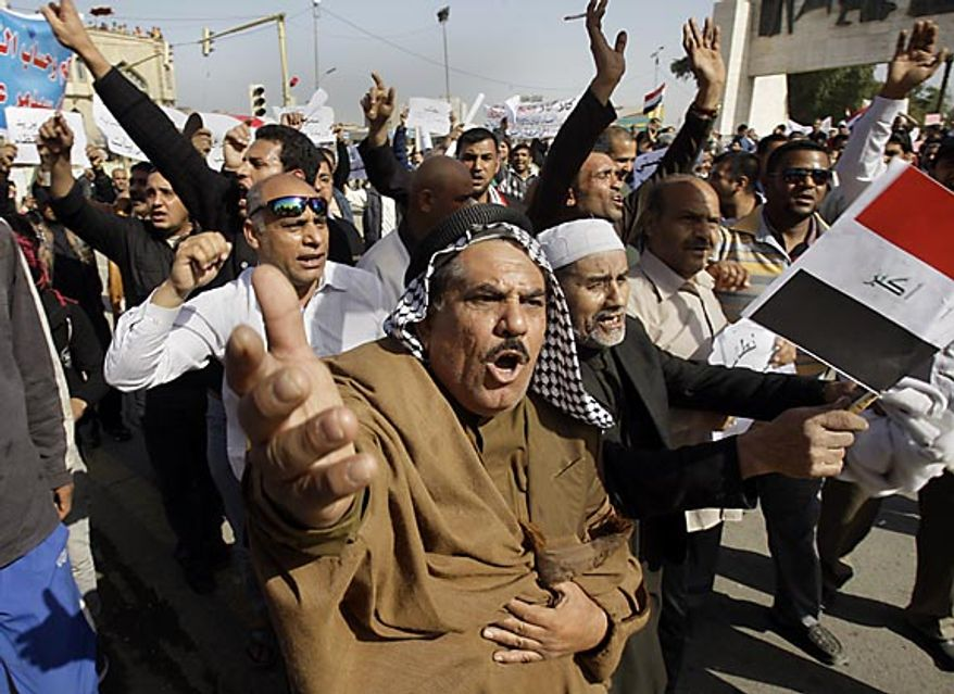 "Protesters chant anti-Iraqi government slogans during a protest at Tahrir Square in Baghdad Friday, Feb. 25, 2011. Iraqi security forces trying to disperse crowds of demonstrators in northern Iraq killed a few people Friday as thousands rallied in cities across the country during what has been billed as the ""Day of Rage."" (AP Photo/Khalid Mohammed)"