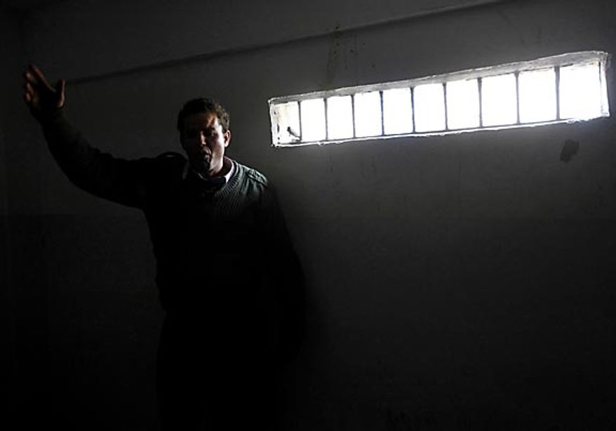 A suspected mercenary is held in a cell at the court in Benghazi, Libya, Friday Feb. 25, 2011. Anti-Gadhafi forces said they had captured the men in their successful fight for control of Benghazi, the country's second-largest city, where mercenaries are being blamed for killing scores of protesters. (AP Photo/Hussein Malla)