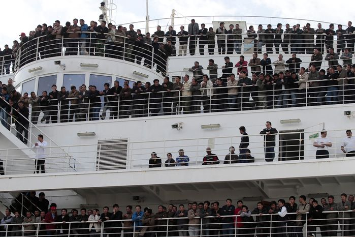 "Chinese citizens wait aboard the ""Palermo Grimaldi"" ferry at the harbor in Valletta, Malta, Saturday, Feb. 26, 2011, after being evacuated from Benghazi, Libya. (AP Photo/Gregorio Borgia)"