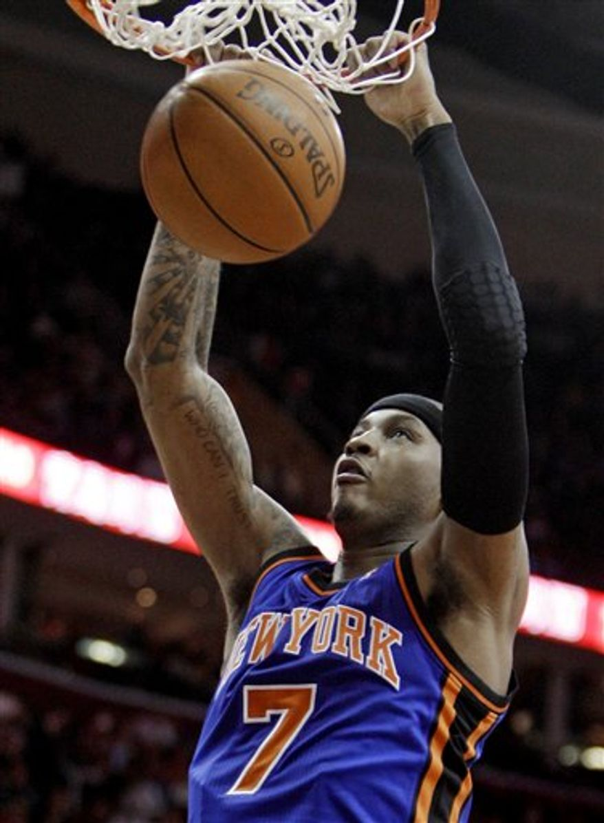 New York Knicks' Carmelo Anthony (7) dunks the ball in the second quarter in an NBA basketball game against the Cleveland Cavaliers Friday, Feb. 25, 2011, in Cleveland. (AP Photo/Tony Dejak)