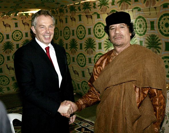 ** FILE ** British Prime Minister Tony Blair greets Libyan leader Col. Moammar Gadhafi at his desert base outside Sirte, south of Tripoli, Libya, in May 2007. (AP Photo)