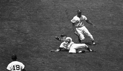 "** CORRECTS YEAR TO 1962, INSTEAD OF 1952 - In this April 29, 1962, file photo, Los Angeles Dodgers' Duke Snider dives for, but misses a hit by Pittsburgh Pirates' Bill Mazeroski during a baseball game in Los Angeles. Snider, 84, died early Sunday, Feb. 27, 2011, of what the family called natural causes at the Valle Vista Convalescent Hospital in Escondido, Calif. Snider was part of the charmed ""Boys of Summer"" with the Dodgers in the late 1940s and 1950s. He helped lead Brooklyn to its only World Series championship in 1955. (AP Photo/Harold Filan, File)"